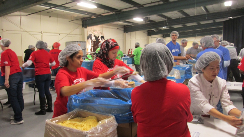 Helping means joy: Employees of WIKA USA packed food for children in famine regions.